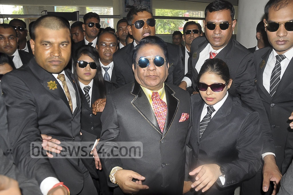 Bangladesh business tycoon Moosa bin Shamsher is surrounded by bodyguards as he arrives for questioning by customs detectives at their Kakrail headquarters in Dhaka on Sunday.