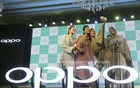 Models take an ussie with Oppo's new F3 smartphone fitted with with dual front cameras. The handset was launched at Dhaka's Le Meridian hotel on Sunday. Photo: asaduzzaman pramanik