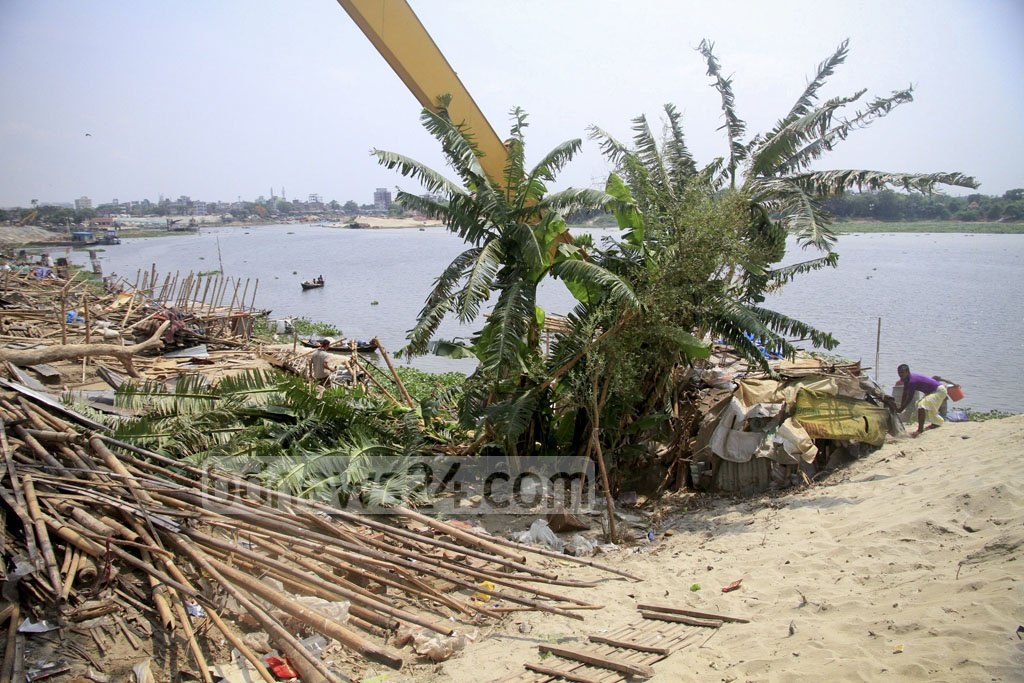 Illegal structures on the embankment beside Turag River are torn down during a drive by the Bangladesh Inland Water Transport Authority on Monday.