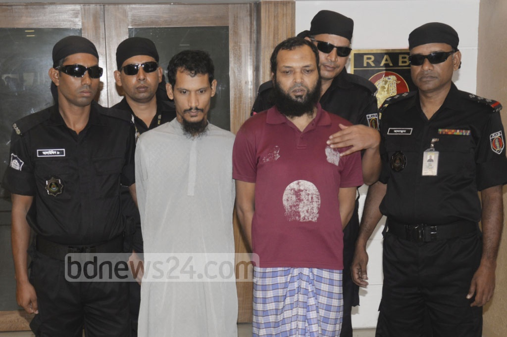 RAB brings two suspected neo-JMB members arrested with bomb making materials in Ashulia before media on Monday.