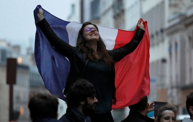 A supporter of President Elect Emmanuel Macron celebrates in Paris, France, May 7, 2017. REUTERS