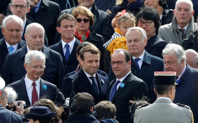 Outgoing French President Francois Hollande (bottom 2ndR) and President-elect Emmanuel Macron (bottom 2ndL) attend a ceremony to mark the end of World War II at the Tomb of the Unknown Soldier at the Arc de Triomphe in Paris, France, May 8, 2017. REUTERS
