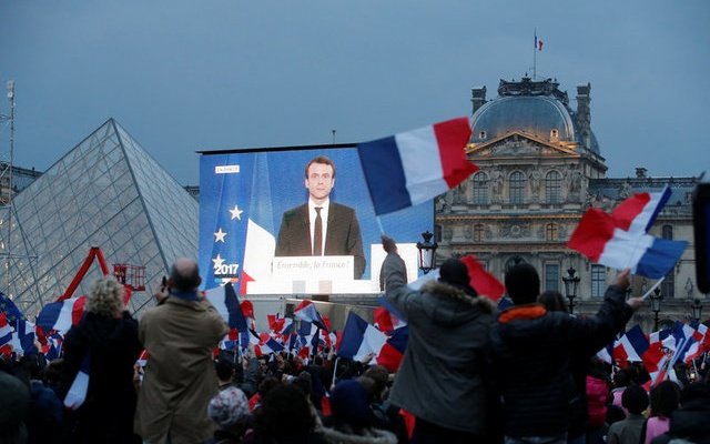 President Elect Emmanuel Macron is seen on a giant screen near the Louvre museum after results were announced in the second round vote of the 2017 French presidential elections, in Paris, France May 7, 2017. Reuters