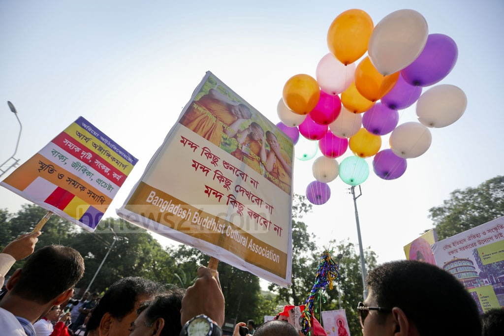 Buddha Purnima revellers, clad in traditional outfits, take part in a rally marking the religious festival on Wednesday. Photo: asaduzzaman pramanik