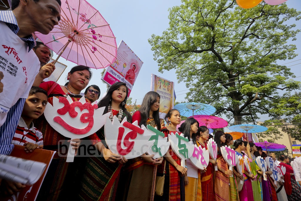 With colourful placards and umbrellas, Bangladesh Buddhist Cultural Association brings out rally marking their biggest religious festival Buddha Purnima in capital Dhaka on Wednesday. Photo: asaduzzaman pramanik