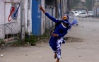 A Kashmiri student throws a stone towards Indian police during a protest in Srinagar April 24, 2017. Reuters