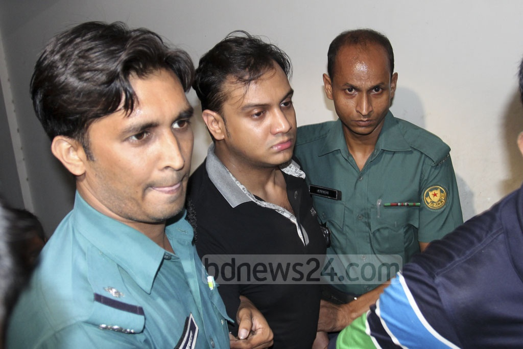 Safat Ahmed, son of one of the owners of Apan Jewellers and the prime accused of the Banani hotel rape case, was brought to the Dhaka Metropolitan Magistrate's Court on Friday for the remand hearing. The court granted police a six-day remand to quiz him in custody. Photo: asif mahmud ove
