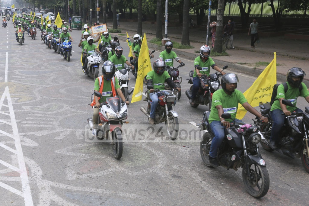 A motorcycle procession with a slogan -- 'slow down, save lives' -- commemorates the UN Global Road Safety Week on Saturday. Leading development organisation BRAC organised the procession. Photo: asaduzzaman pramanik