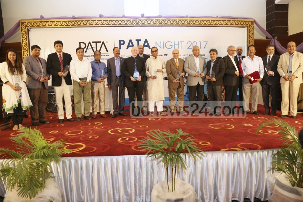 Awardees pose for a group photo at PATA Night 2017 at Dhaka Regency hotel on Saturday. The Pacific Asia Travel Association or PATA awarded 15 individuals and organisations for their outstanding contributions to the tourism sector.