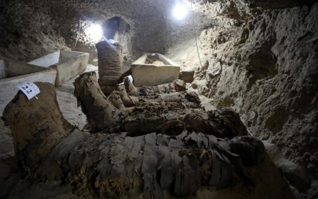 A number of mummies inside the newly discovered burial site in Minya, Egypt May 13, 2017. Reuters