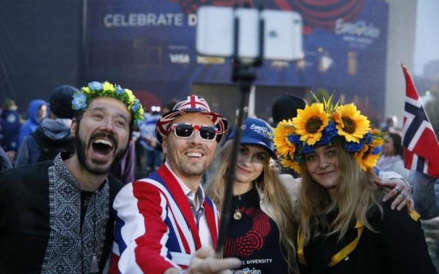 Fans arrive at the Eurovision Song Contest 2017 Grand Final at the International Exhibition Centre in Kiev, Ukraine, May 13, 2017. Reuters