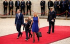 Laurence Auziere Jourdan, daughter of Brigitte Trogneux, her husband Guillaume and their children arrive to attend the handover ceremony between French President-elect Emmanuel Macron and outgoing President Francois Hollande at the Elysee Palace in Paris, France, May 14, 2017. Reuters