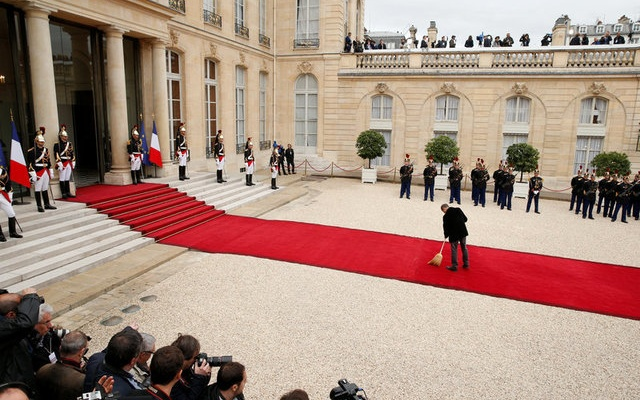 A worker cleans up the red carpet before the handover ceremony between French President-elect Emmanuel Macron and outgoing President Francois Hollande at the Elysee Palace in Paris, France, May 14, 2017. Reuters