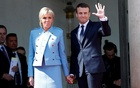 French President Emmanuel Macron and his wife Brigitte Trogneux wave to French President Francois Hollande (not pictured) as he leaves after the handover ceremony at the Elysee Palace in Paris, France, May 14, 2017. Reuters