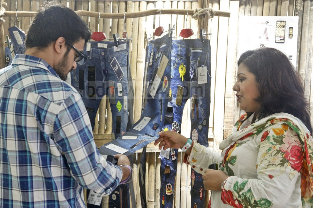 Visitors check out jeans on the first day of the Bangladesh Denim Expo at the International Convention City Bashundhara in Dhaka on Wednesday.