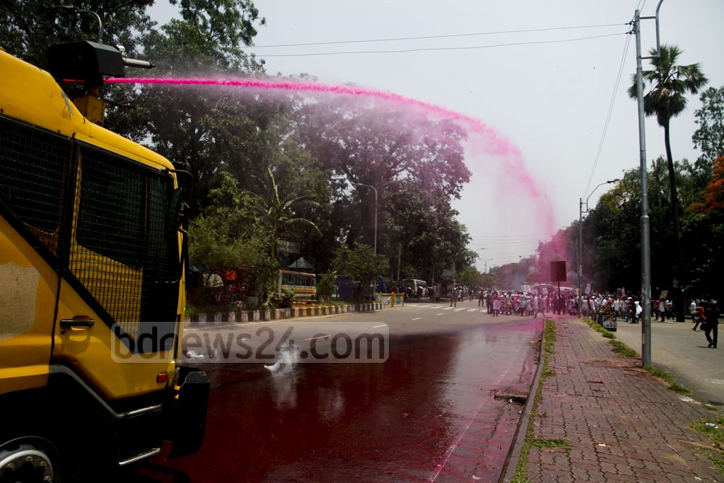 A police water cannon fires at protesting students from Medical Assistance Training School or MATS at Dhaka University on Thursday. Photo: tanvir ahammed