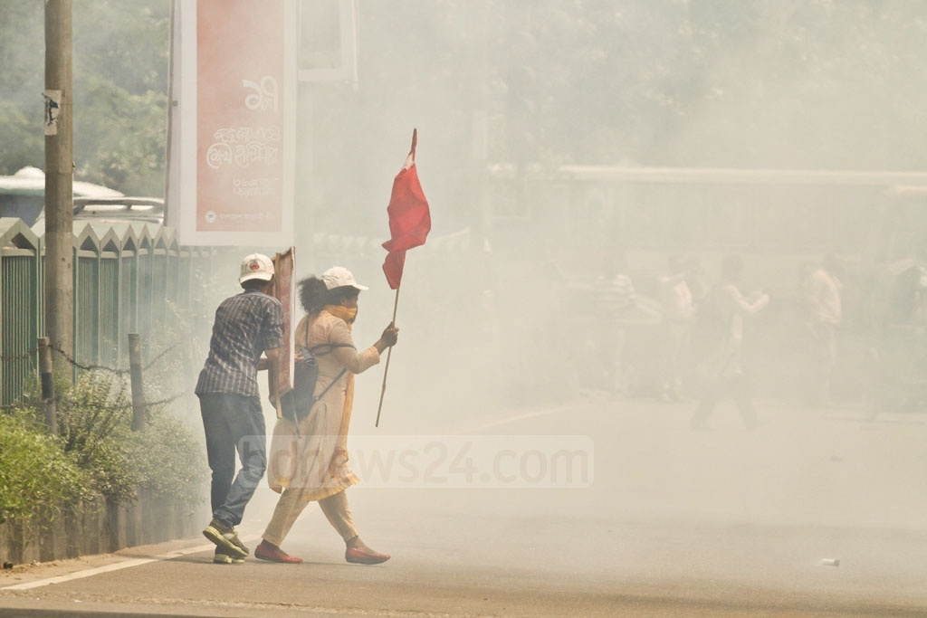 Police stop Samajtantrik Chhatra Front activists on Thursday when they tried to lay siege to the UGC building at Shahbagh demanding cancellation of the announcement of five-fold increase in tuition fees at public universities.