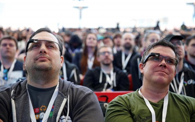 Two attendees wearing Google Glass listen to the opening keynote during the annual Google I/O developers conference in San Jose, California, U.S., May 17, 2017. Reuters