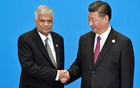Sri Lanka's Prime Minister Ranil Wickremesinghe (L) shakes hands with Chinese President Xi Jinping during the welcome ceremony for the Belt and Road Forum, at the International Conference Center in Yanqi Lake, north of Beijing, China May 15, 2017. Reuters