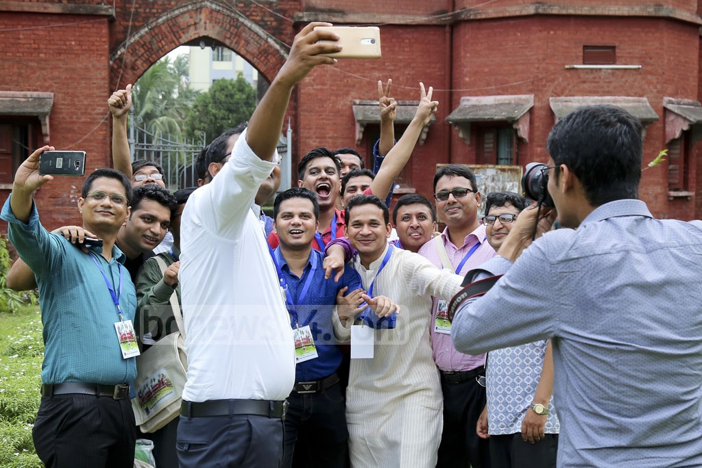 Alumni from Dhaka University's Fazlul Huq Hall gather for a group selfie during their reunion on Friday.