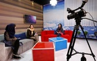 Afghan presenters record their morning programme at the Zan TV station (women's TV) in Kabul, Afghanistan May 8, 2017. Reuters