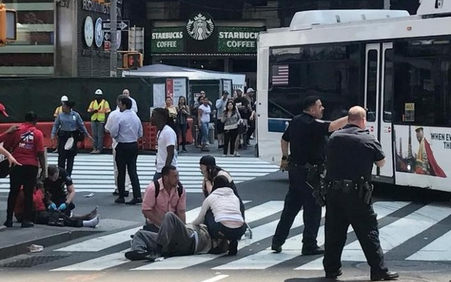 First responders at the scene as people help injured pedestrians. Reuters