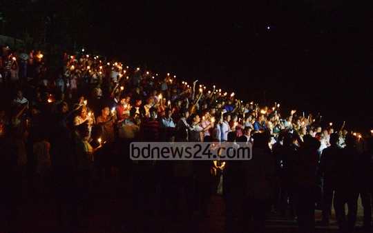 Chittagong Metropolitan Police organises a candle light vigil in the city on Sunday as part of a symbolic response to the darkness of militancy, terrorism and drugs.
