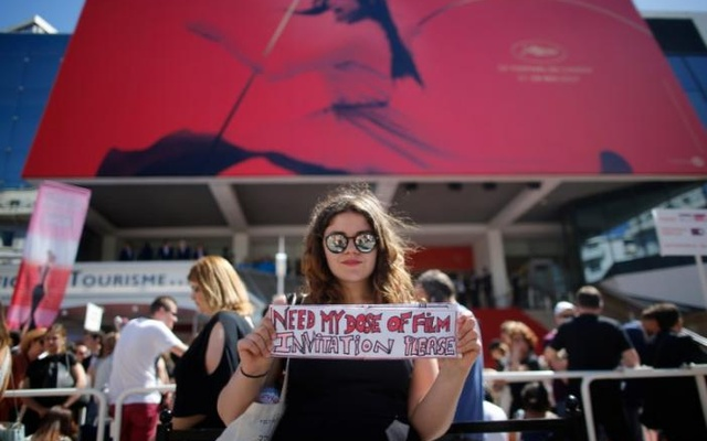 70th Cannes Film Festival - Screening of the film '120 battements par minute' (120 Beats Per Minute) in competition - Cannes, France on May 20. A cinema fan looks for tickets in front of the Festival Palace. Reuters
