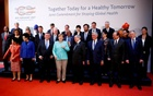 German Chancellor Angela Merkel poses for a group picture at a meeting of the G20 health ministers in Berlin, Germany, May 19, 2017. Reuters