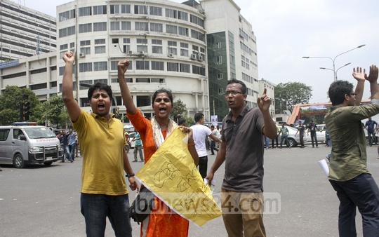 Students block the road through Shahbagh in Dhaka on Monday to demand an end to question leaks.