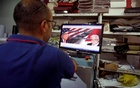 A Palestinian man prints posters depicting U.S. President Donald Trump in preparations for his planned visit, in the West Bank town of Bethlehem May 21, 2017. Reuters