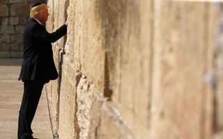 US President Donald Trump places a note in the stones of the Western Wall, Judaism's holiest prayer site, in Jerusalem's Old City on May 22, 2017. Reuters