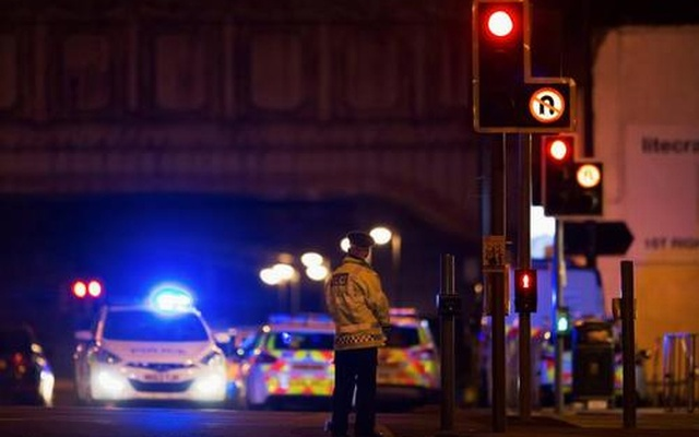 Police vehicles and a police officer are seen outside the Manchester Arena, where US singer Ariana Grande had been performing in Manchester, northern England, Britain May 22, 2017. Reuters
