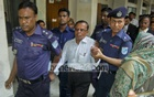 Police escort Shyamal Kanti Bhakta to a prison van after the teacher turned himself in on bribery charges in Narayanganj on Wednesday.
