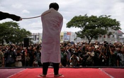 FILE PHOTO: An Indonesian man is publicly caned for having gay sex, in Banda Aceh, Aceh province, Indonesia May 23, 2017. Reuters