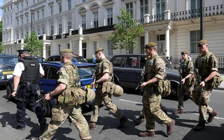 Soldiers cross a road with a police officer in central London, BritainMay 24, 2017. Reuters