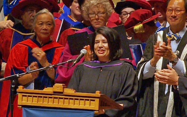 Rumana Monzur receives a standing ovation following her speech to fellow law school graduates and faculty at the University of British Columbia. Photo: CBC News