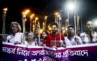 Ganajagaran Mancha activists take out a torch procession in Dhaka University area on Friday to protest against the removal of the Lady Justice statue from the Supreme Court premises.