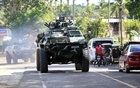 An armoured personnel carrier belonging to government troops drives along a main highway of Pantar town, Lanao Del Norte, as it travels to reinforce Marawi city, southern Philippines May 24, 2017. Reuters