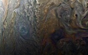 NASA's enhanced-color image of a mysterious dark spot on Jupiter shows a Jovian ''galaxy'' of swirling storms in this image captured by NASA's Juno spacecraft on February 2, 2017, at 5:13 a.m. PDT (8:13 a.m. EDT), at an altitude of 9,000 miles (14,500 kilometers) above... Reuters