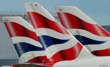 FILE PHOTO: British Airways logos are seen on tailfins at Heathrow Airport in west London, Britain May 12, 2011. Reuters