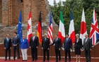 From L-R, European Council President Donald Tusk, Canadian Prime Minister Justin Trudeau, German Chancellor Angela Merkel, US President Donald Trump, Italian Prime Minister Paolo Gentiloni, French President Emmanuel Macron, Japanese Prime Minister Shinzo Abe, Britain's Prime Minister Theresa May and European Commission President Jean-Claude Juncker pose for a family photo during the G7 Summit in Taormina, Sicily, Italy, May 26, 2017. Reuters