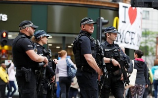 Armed police officers stand on duty in central Manchester, Britain, May 28, 2017. Reuters