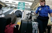 A TSA worker loads suitcases at the checked luggage security screening station at Los Angeles International Airport in Los Angeles, California, US on September 7, 2011. Reuters