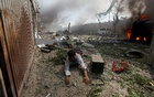 A wounded man lies on the ground at the site of a blast in Kabul, Afghanistan May 31, 2017. Reuters