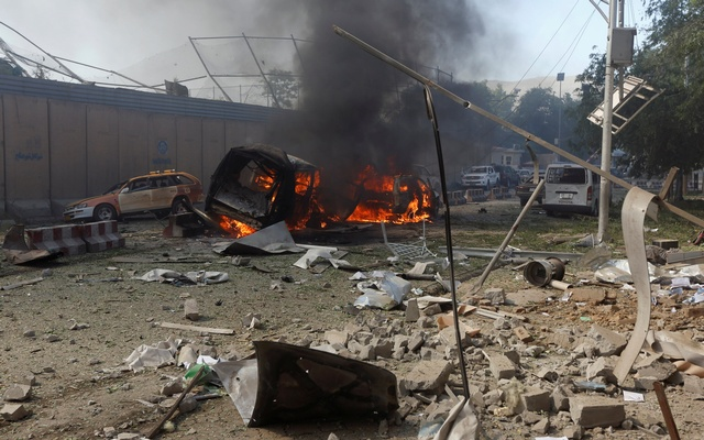 Burned vehicles are seen after a blast at the site of the incident in Kabul, Afghanistan May 31, 2017. Reuters