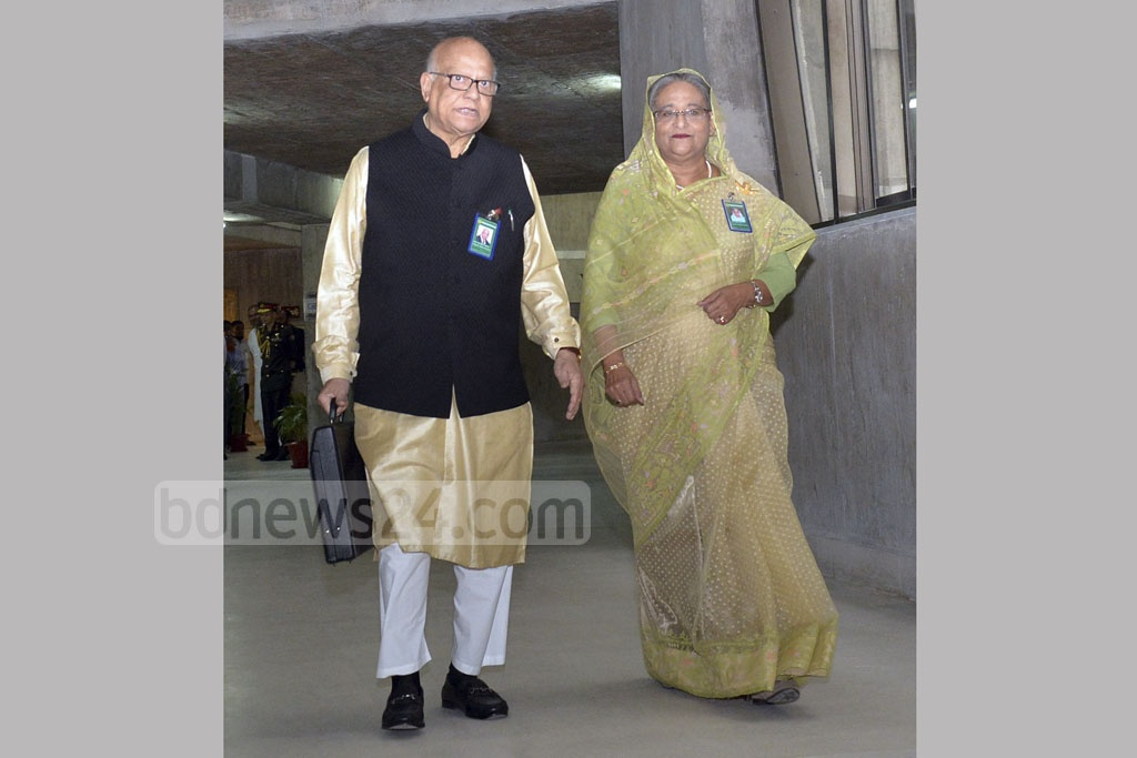 Finance Minister AMA Muhith and Prime Minister Sheikh Hasina coming out after the special Cabinet meeting that approved national budget for fiscal 2017-18 on Thursday. Muhith is carrying the list of expenditures for the upcoming fiscal year inside the black briefcase for presentation in parliament. Photo: PID