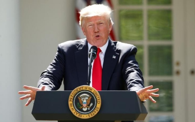 FILE PHOTO: U.S. President Donald Trump announces his decision that the United States will withdraw from the Paris Climate Agreement, in the Rose Garden of the White House in Washington, U.S., June 1, 2017. Reuters