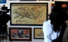 Walt Disney's original 1953 Disneyland map is seen on display during a press preview for the upcoming auction ''Walt Disney's Disneyland'' at Van Eaton Galleries in Sherman Oaks, California, US. Reuters
