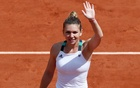 Halep hammers hapless Spaniard in French rout